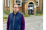 Greg is stood outside the Long Crendon Surgery building in late-August 2020